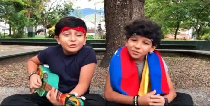 Niños músicos dedican canción a atletas - Niños músicos dedican canción a atletas